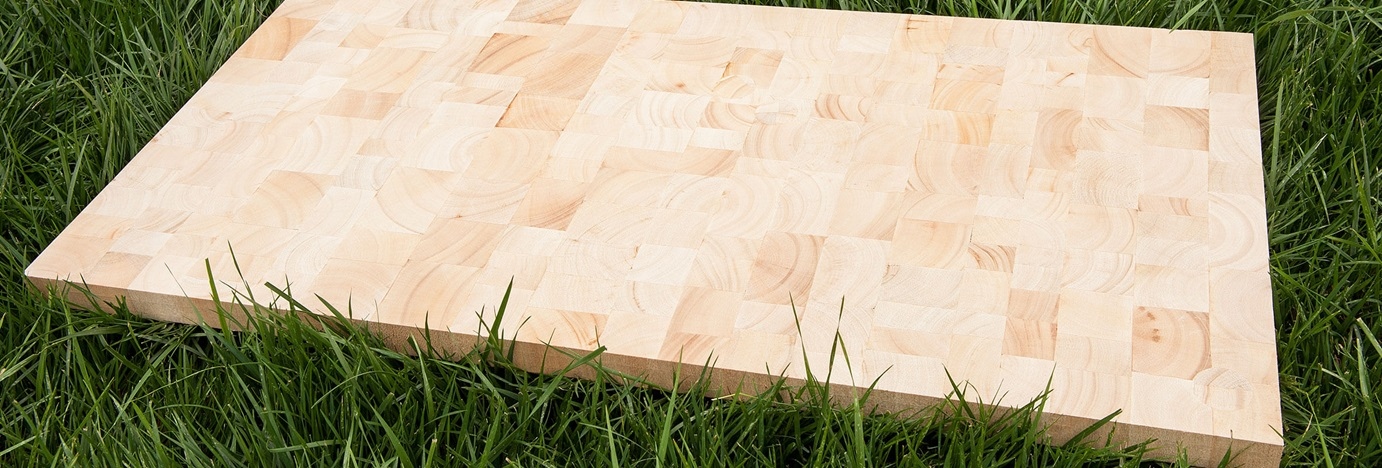 Wooden board on grass